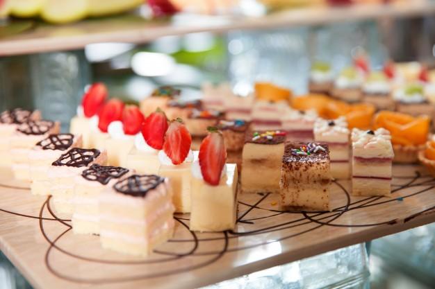 delicious-mini-cakes-buffet-table_1262-1801
