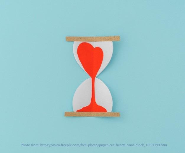 paper-cut-hearts-sand-clock_1232-3636