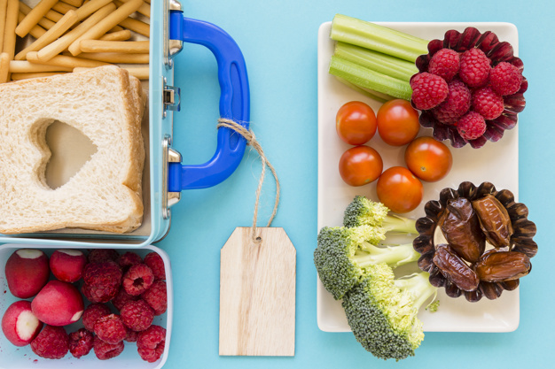 fruits-vegetables-near-nice-lunchbox_23-2147866368