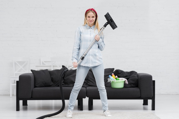 woman-holding-vacuum-cleaner_23-2148394903