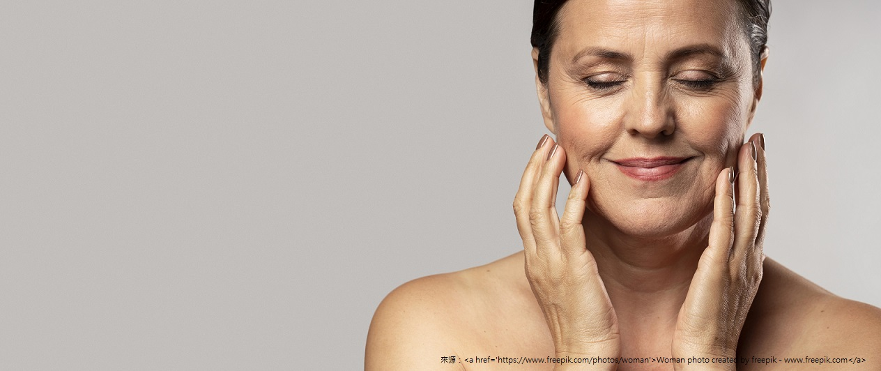 smiley-older-woman-with-make-up-posing-with-hands-face-copy-space